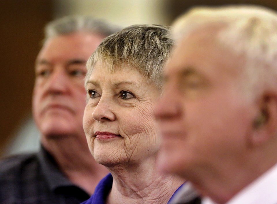 Photo - Gail Shepherd sits with her husband, Galen, left, and others as they listen to three US Senate candidates debate Wednesday,  Monday, April 16, 2014. Shepherd said she traveled with a group of six from Weatherford to attend the event. Photo by Jim Beckel, The Oklahoman