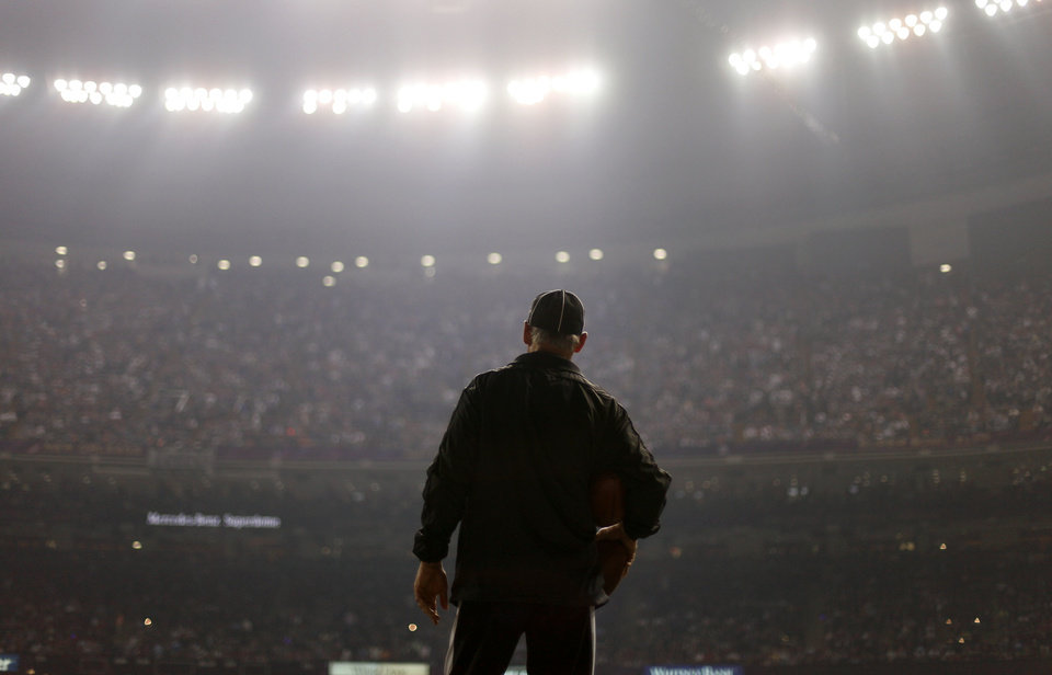 Photo - An official looks on during a Superdome power outage in the second half of the NFL Super Bowl XLVII football game between the San Francisco 49ers and the Baltimore Ravens, Sunday, Feb. 3, 2013, in New Orleans. (AP Photo/David Goldman)