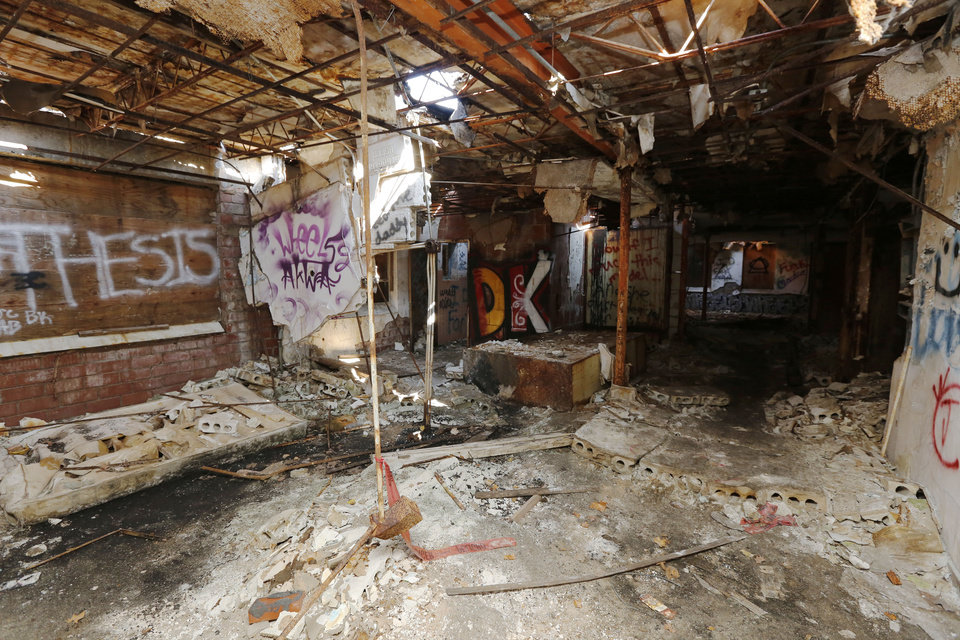 Photo -  A former nursing home, St. Vincent's Home in northeast Oklahoma City has been neglected for years. City officials struggle to deal with abandoned property, which is expensive to clear.