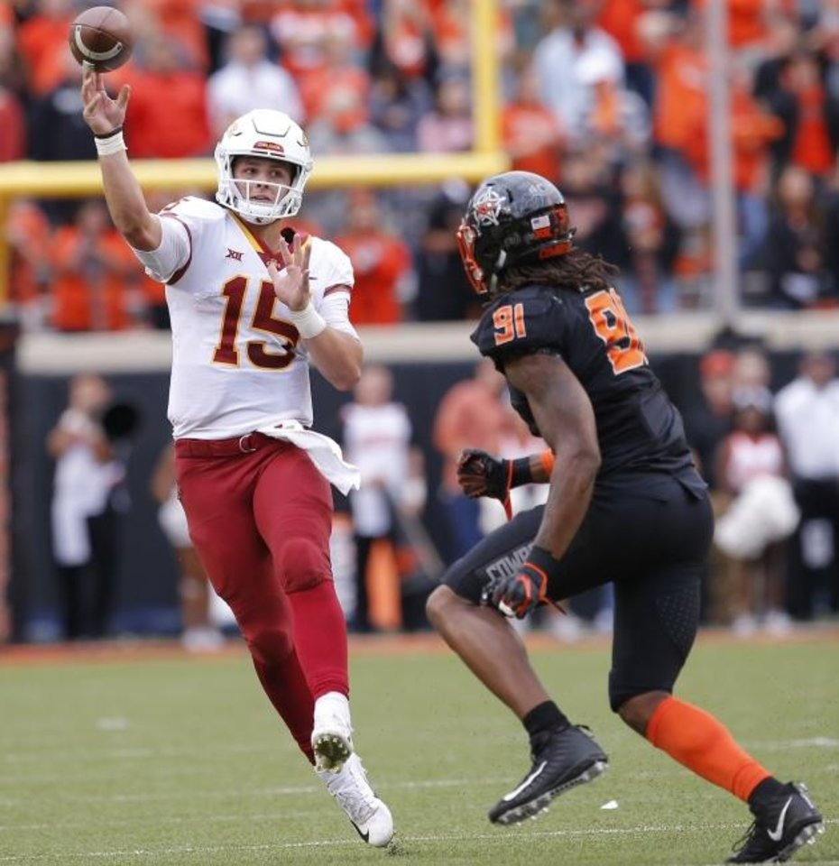 Photo -  Iowa State's Brock Purdy throws a pass as he is defended by Oklahoma State's Mike Scott last season in Stillwater. [Sarah Phipps/The Oklahoman]