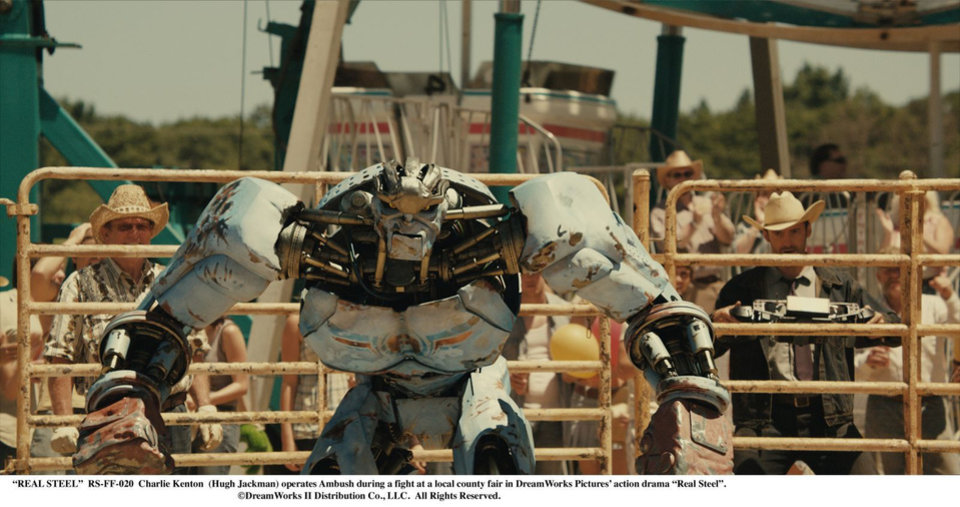 """Photo -  """"REAL STEEL""""  RS-FF-020  Charlie Kenton  (Hugh Jackman) operates Ambush during a fight at a local county fair in DreamWorks Pictures' action drama """"Real Steel"""".  ©DreamWorks II Distribution Co., LLC. All Rights Reserved."""