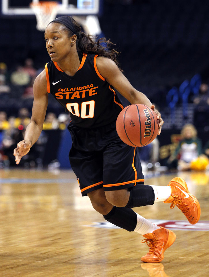 Photo - Oklahoma State's Roshunda Johnson (00) drives to the basket during the Women's Big 12 basketball tournament game between Baylor and Oklahoma State at Chesapeake Energy Arena  in Oklahoma City, Okla., Sunday, March 9, 2014. Photo by Sarah Phipps, The Oklahoman