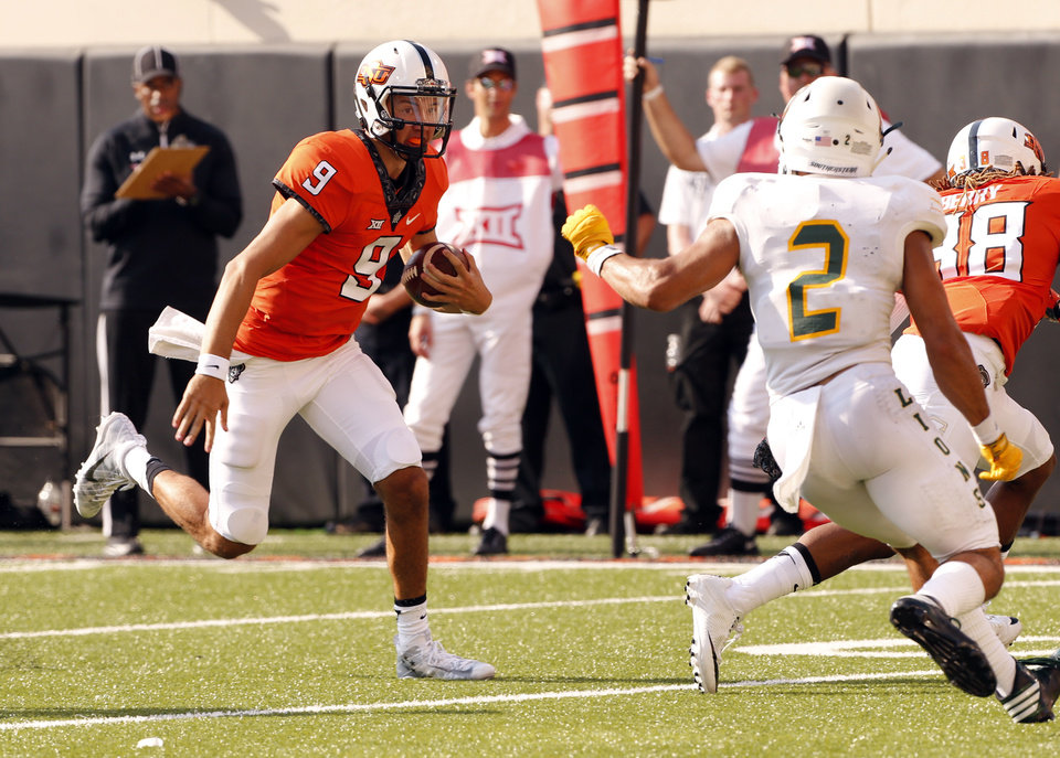 Photo - Oklahoma State quarterback John Kolar (9) keeps the ball during the second half of a college football game between the Oklahoma State Cowboys (OSU) and the Southeastern Louisiana Lions at Boone Pickens Stadium in Stillwater, Okla., Saturday, Sept. 12, 2015. Photo by Steve Sisney, The Oklahoman