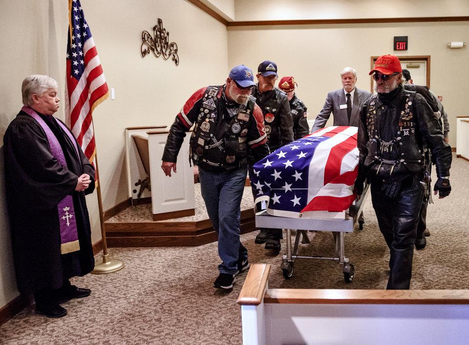 Photo -  Members of the Patriot Guard Riders carry the casket of homeless Army veteran William Eugene Weeks Jr., 64, out of the chapel after his funeral Wednesday at Chapel Hill Funeral Home in Oklahoma City. [Photo by Chris Landsberger, The Oklahoman]