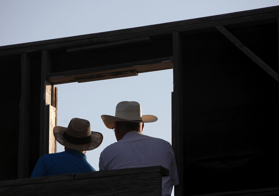 Two announcer look out over the arena during the Pawnee Bill Wild West Show at the Pawnee Bill Ranch in Pawnee, Oklahoma on Saturday,   June 23, 2012. They are seen from backstage.  Photo by Jim Beckel, The Oklahoman