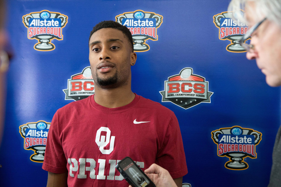 Oklahoma defensive back Aaron Colvin speaks to reporters after arriving in New Orleans on Friday, Dec. 27, 2013. Oklahoma plays Alabama in the Sugar Bowl NCAA college football game on Jan. 2. (AP Photo/Rusty Costanza)