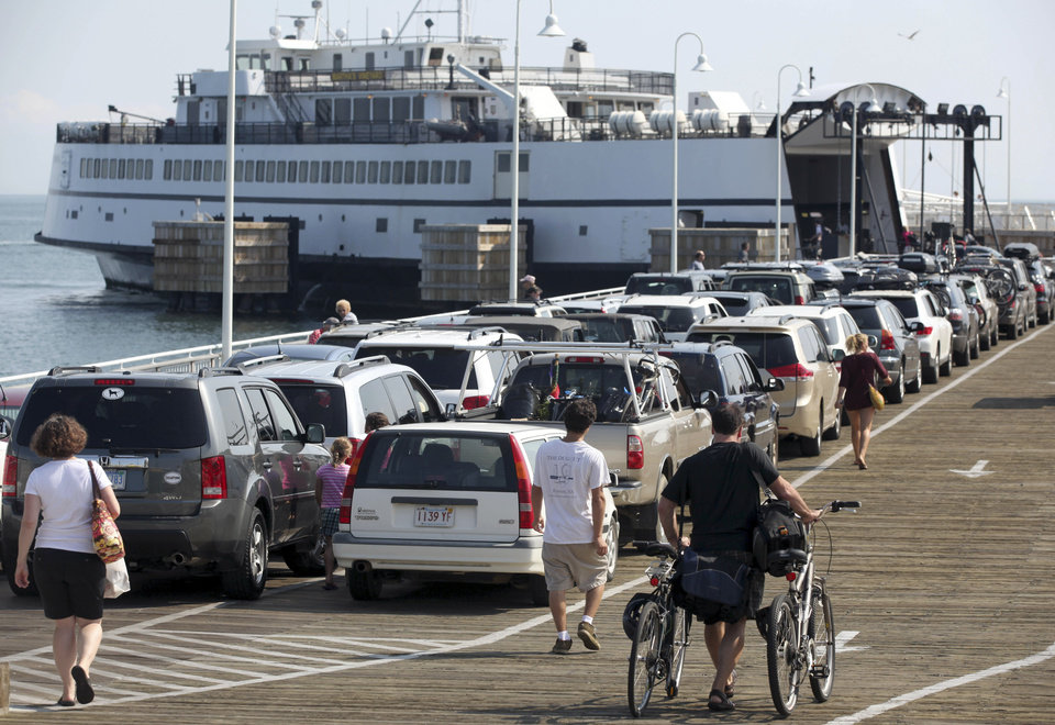 Photo - FILE - In this Aug. 26, 2011, file photo, passengers with cars and bicycles prepare to board a ferry departing the island of Martha's Vineyard, in Oak Bluffs, Mass. Leaders of the Aquinnah Wampanoag tribe propose to convert an unfinished community center on the island into a high-stakes bingo and poker hall, hoping to tap into the influx of tourist dollars each summer. (AP Photo/Steven Senne, File)