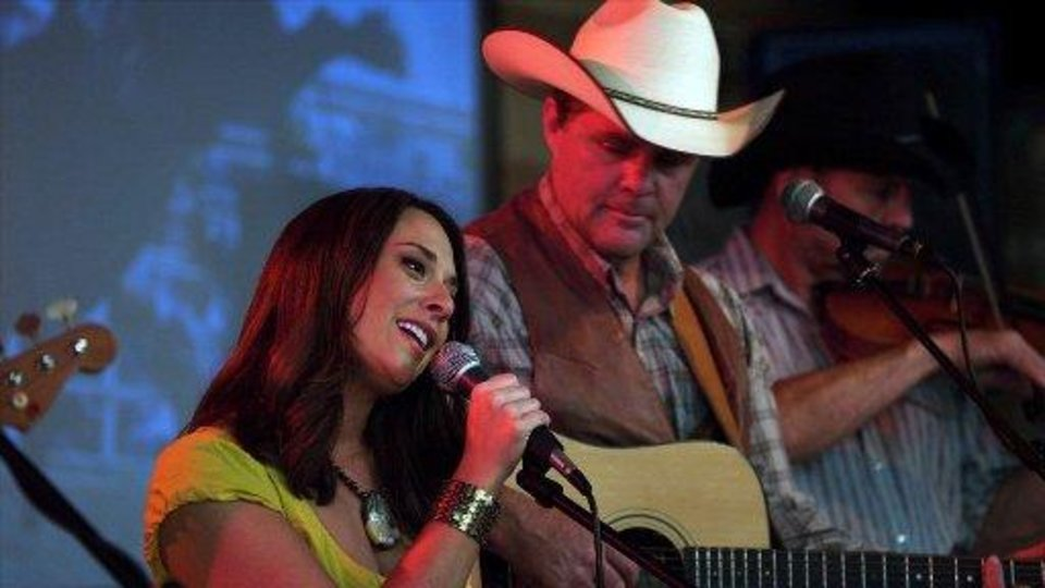"Oklahoma-born and bred singer-songwriter Amber Hayes and former Lonestar frontman Richie McDonald appear in a scene from ""Cowgirls N' Angels."""