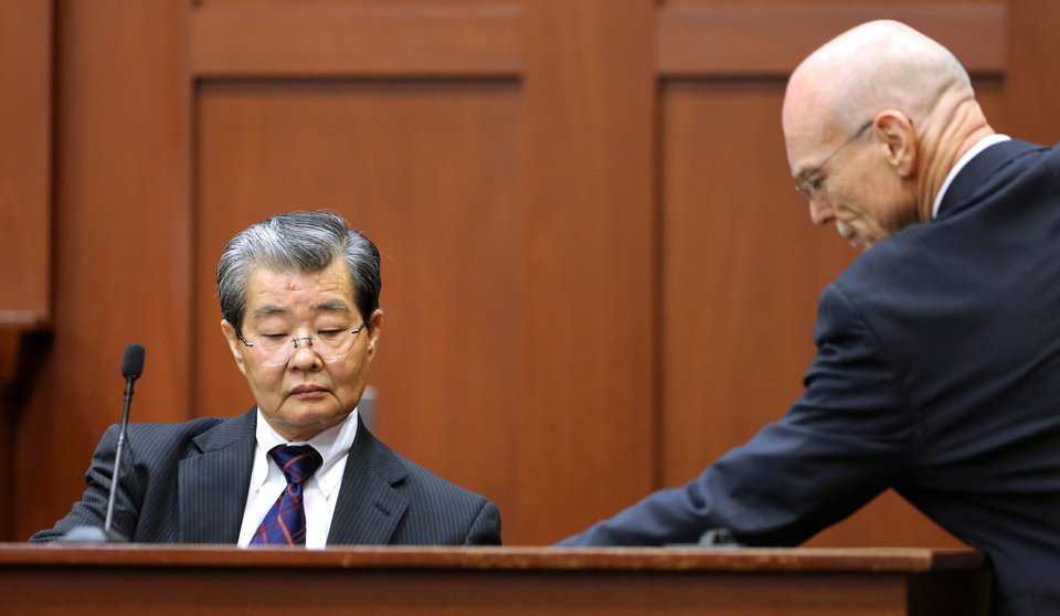 George Zimmerman's defense attorney Don West, right, presents state witness Dr. Hirotaka Nakasone, left, a senior voice recognition scientist with the FBI, with a marked exhibit as Nakasone testifies in the Zimmerman's trial in Seminole circuit court, in Sanford, Fla., Monday, July  1, 2013.  Zimmerman has been charged with second-degree murder for the 2012 shooting death of Trayvon Martin.(AP Photo/Orlando Sentinel, Joe Burbank, Pool)