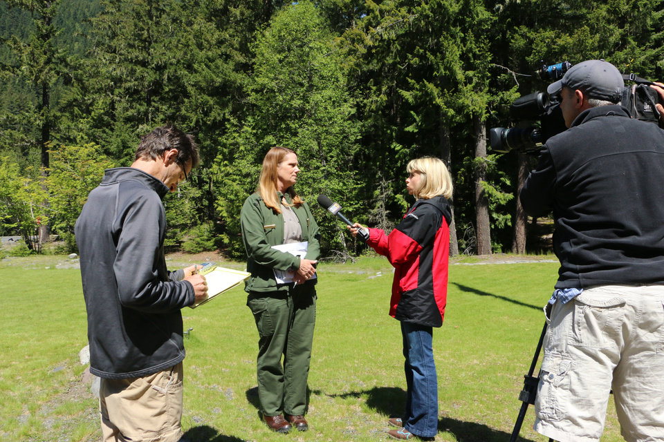 Photo - Mount Rainier National Park spokeswoman Patti Wold talks to the media outside of the park's headquarters on Sunday, June 1, 2014. Officials said that there are no immediate plans to recover the bodies of six climbers who likely fell thousands of feet to their deaths in the worst alpine accident on the mountain in decades. (AP Photo/Rachel La Corte)