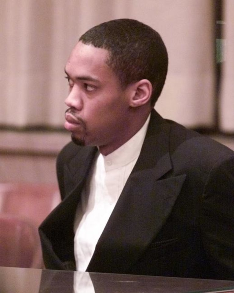 Photo -  At his 2002 sentencing, Julius Jones listens as jurors select the death penalty as his punishment. [Oklahoman archive photo]