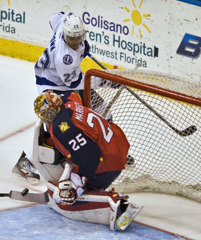 Photo - nFlorida Panthers goalie Jacob Markstrom (25) stops a shot from Tampa Bay Lightning's J.T. Brown (23) during the second period of a NHL preseason hockey game Thursday, Sept. 26, 2013, in Estero, Fla. (AP Photo/Steve Nesius)