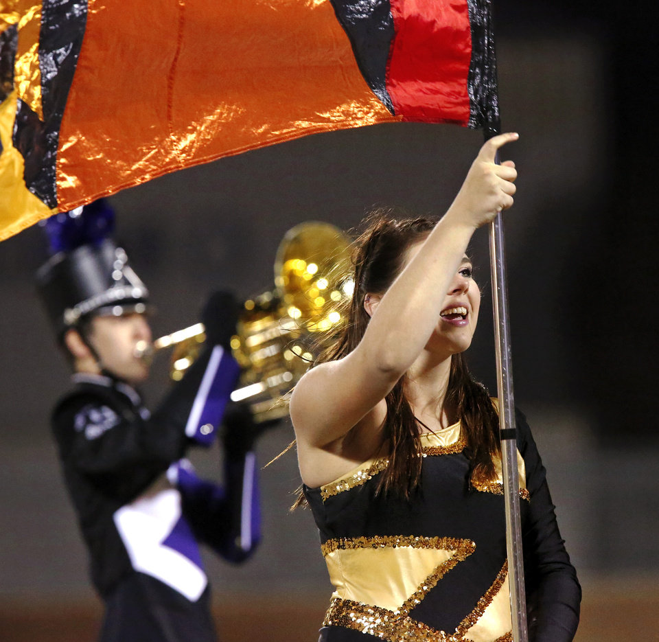 Photo - Bethany senior Annaleise Peters performs as a member of the band's color guard during the halftime show. Tuttle at Bethany in Class 3A first round high school football playoff game.  Friday, Nov. 15, 2013.  Photo by Jim Beckel, The Oklahoman