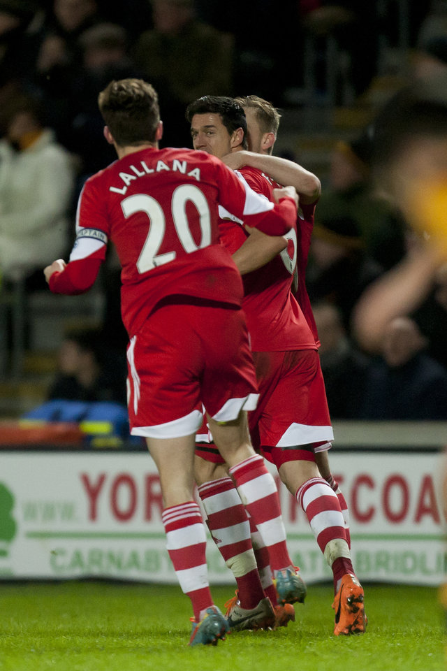 Photo - Southampton's Jose Fonte, center, celebrates with teammates after scoring against Hull City during their English Premier League soccer match at the KC Stadium, Hull, England, Tuesday Feb. 11, 2014. (AP Photo/Jon Super)