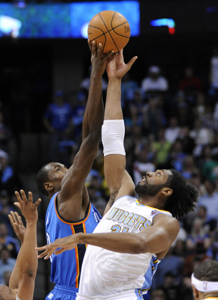 Photo - Oklahoma City Thunder forward Serge Ibaka (9) from the Republic of Congo and Denver Nuggets center Nene (31) from Brazil go up for the ball at tip off during the first half in game 4 of a first-round NBA basketball playoff series Monday, April 25, 2011, in Denver. (AP Photo/Jack Dempsey)