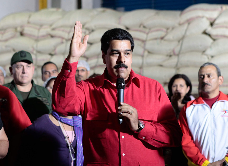 "In this photo provided by Miraflores Presidential Press Office, Venezuela's Vice-President Nicolas Maduro, center, delivers a speech during a visit to ""Fama de America"" government-run coffee plant in Caracas, Venezuela, Thursday, Jan. 3, 2013. Maduro said Thursday that reports of recent contacts between U.S. and Venezuelan diplomats have been distorted and that Venezuela's President Hugo Chavez authorized the conversations. (AP Photo/Miraflores Presidential Press Office)"