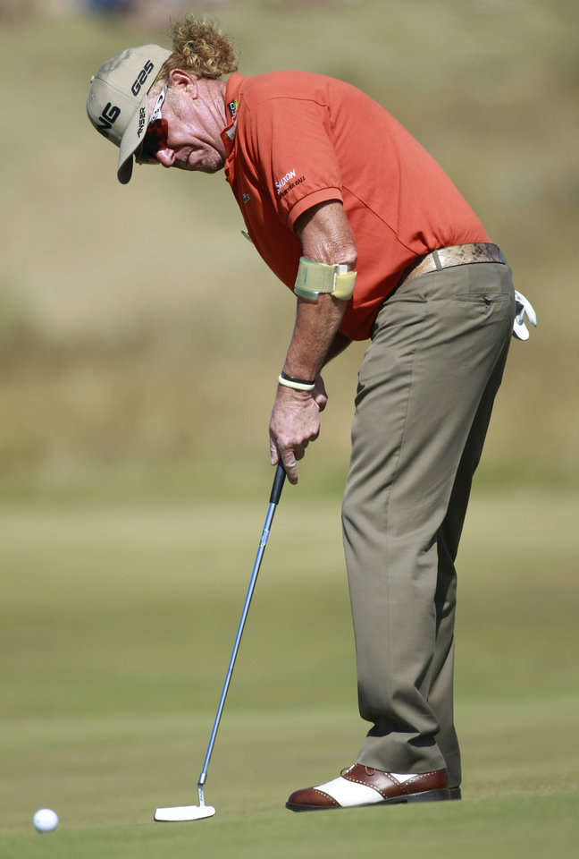 Photo - Miguel Angel Jimenez of Spain putts during the second round of the British Open Golf Championship at Muirfield, Scotland, Friday July 19, 2013. (AP Photo/Peter Morrison)