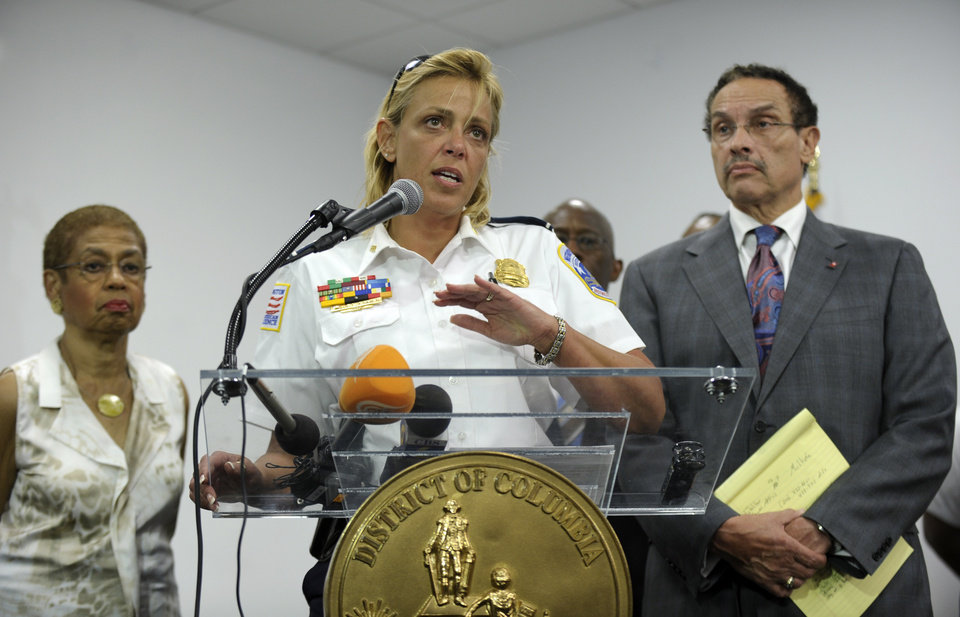 Photo - District of Columbia Police Chief Cathy Lanier, center, flanked by Rep. Eleanor Holmes Norton, D-D.C., left, and District of Columbia Mayor Vincent Gray, right, briefs reporters on the shooting at the Washington Navy Yard in Washington, Monday, Sept. 16, 2013. (AP Photo/Susan Walsh)