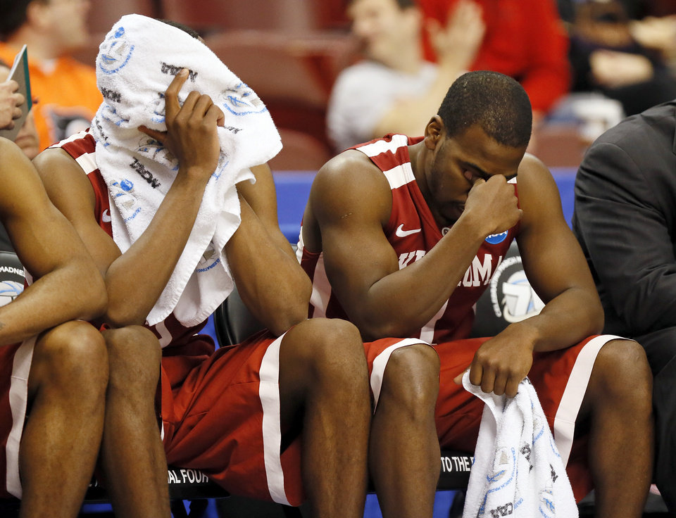 Oklahoma\'s Buddy Hield (3), left, and Oklahoma\'s Sam Grooms (1) sit on the bench late in the second half of a game between the University of Oklahoma and San Diego State in the second round of the NCAA men\'s college basketball tournament at the Wells Fargo Center in Philadelphia, Friday, March 22, 2013. San Diego State beat OU, 70-55. Photo by Nate Billings, The Oklahoman