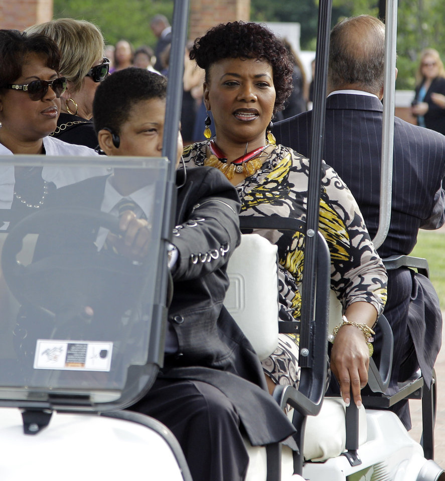 Photo - Bernice King, center, daughter of Martin Luther King, Jr, arrives outside Wait Chapel before a memorial service for poet and author Maya Angelou at Wait Chapel. at Wake Forest University in Winston-Salem, N.C., Saturday, June 7, 2014. Former President Bill Clinton and Oprah Winfrey are joining First Lady Michelle Obama at the service. (AP Photo/Chuck Burton)