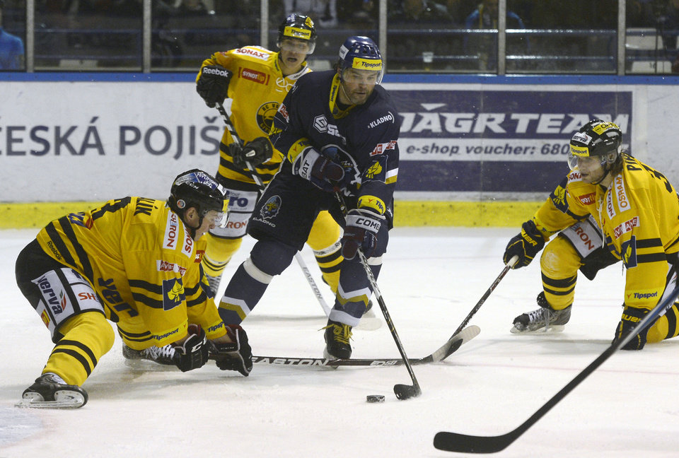 Jaromir Jagr, centre, is surrounded by his opponents during a good-bye match in which his Czech team of Rytiri Kladno defeated HC Verva Litvinov in Kladno, Czech Rep., on Tuesday, Jan. 8, 2013. Jagr surprised his fans and took part in the match, while many of his NHL colleagues have already departed back to the US. and Canada as the NHL lock-out finished. Jagr plays for the Dallas Stars in the US. (AP Photo/CTK, Michal Kamaryt) SLOVAKIA OUT