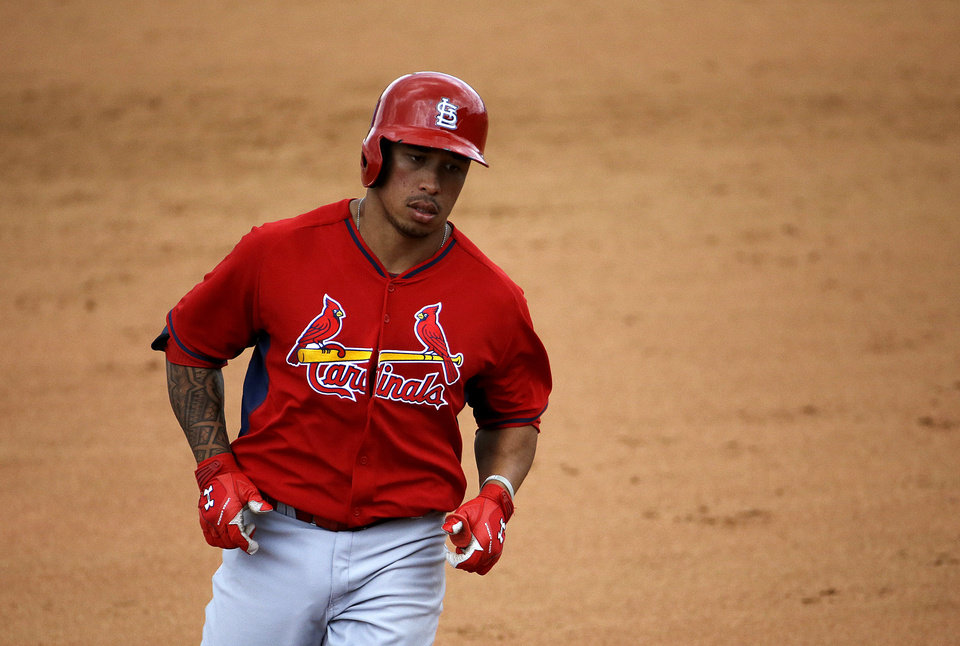 Photo - St. Louis Cardinals' Kolten Wong rounds the bases after hitting a two-run home run to score teammate Stephen Piscotty in the seventh inning of an exhibition spring training baseball game against the New York Mets, Wednesday, March 12, 2014, in Port St. Lucie, Fla. (AP Photo/David Goldman)
