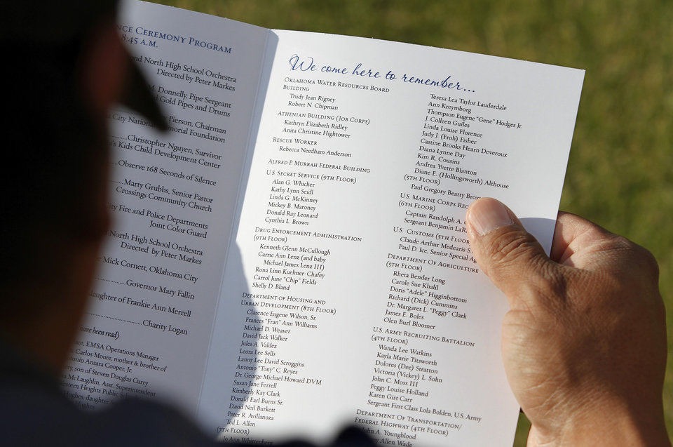 A man reads the printed program before the ceremony begins. An estimated crowd of 2,000  attended the  Remembrance Ceremony to mark  the 17th anniversary of the 1995 bombing of the Alfred P. Murrah Federal Building in downtown Oklahoma City in which 168 people were killed.  Photo taken April 19, 2012.        Photo by Jim Beckel, The Oklahoman