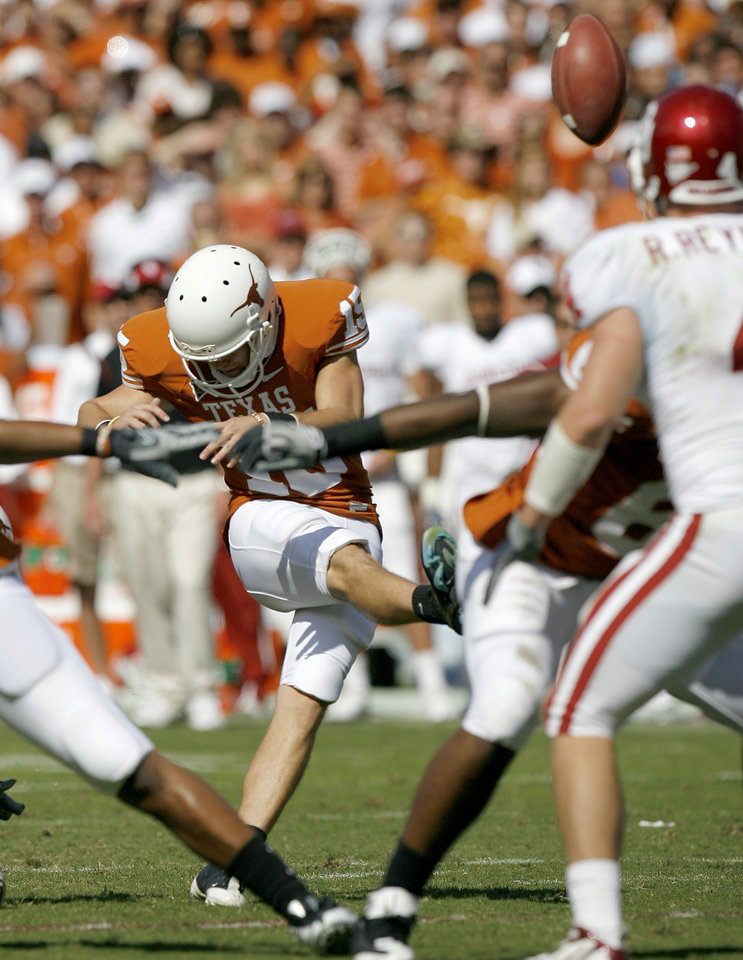 Photo - Hunter Lawrence kicks a field goal for Texas in the fourth quarter of the Red River Rivalry college football game between the University of Oklahoma Sooners (OU) and the University of Texas Longhorns (UT) at the Cotton Bowl in Dallas, Texas, Saturday, Oct. 17, 2009. Photo by Bryan Terry, The Oklahoman