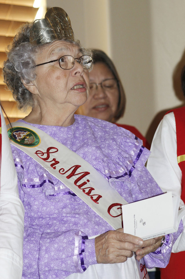Sue Morgan, Senior Miss Oklahoma City Muscogee (Creek) Association, sings during the Native American Heritage Celebration on Monday.