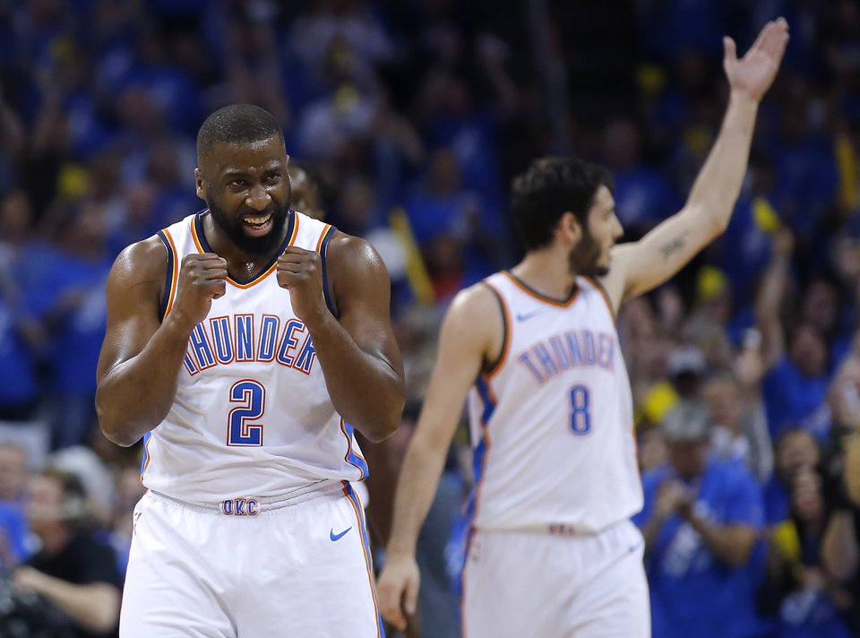 Photo -  Oklahoma City's Alex Abrines, right, gets the crowd fired up while Raymond Felton celebrates a basket during Game 1 of a Western Conference playoff series on Sunday against Utah. [PHOTO BY SARAH PHIPPS, THE OKLAHOMAN]