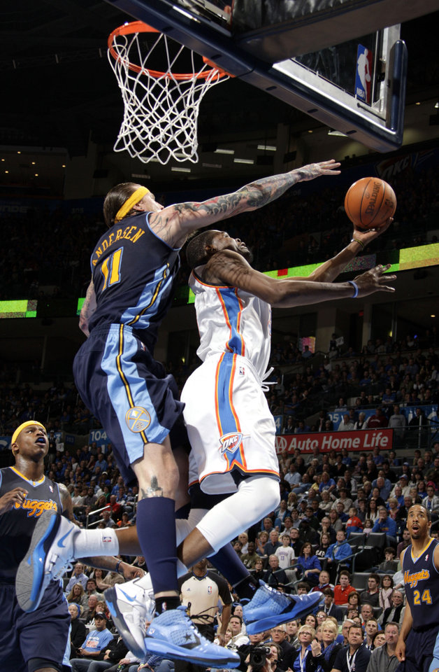 Oklahoma City's Kevin Durant (35) shoots a lay up as Denver's Chris Andersen (11) defends during the NBA basketball game between the Oklahoma City Thunder and the Denver Nuggets at the Chesapeake Energy Arena, Sunday, Feb. 19, 2012. Photo by Sarah Phipps, The Oklahoman