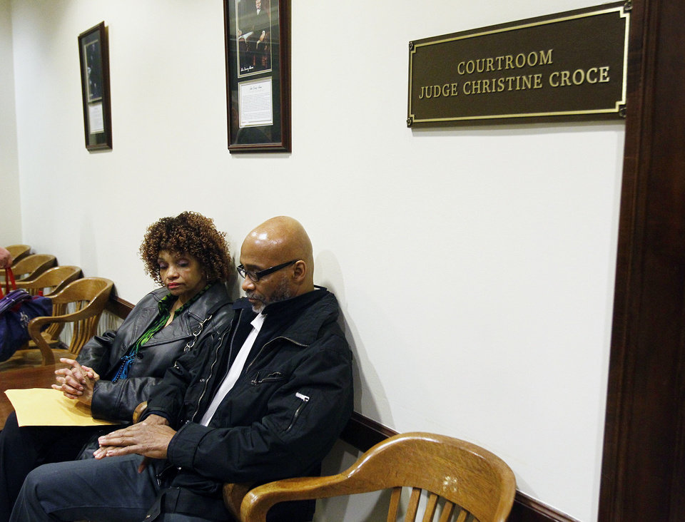Photo - Douglas Prade and his sister Yvonne Prade wait outside the courtroom before his hearing at the Summit County Courthouse, Thursday, March 20, 2014, in Akron, Ohio. A judge ordered Prade to appear in court Thursday so she could decide whether he should be sent back to prison or remain free while he appeals. Prade could head back to prison after being exonerated in his ex-wife's killing, he served 15 years. (AP Photo/Akron Beacon Journal, Karen Schiely)  MANDATORY CREDIT