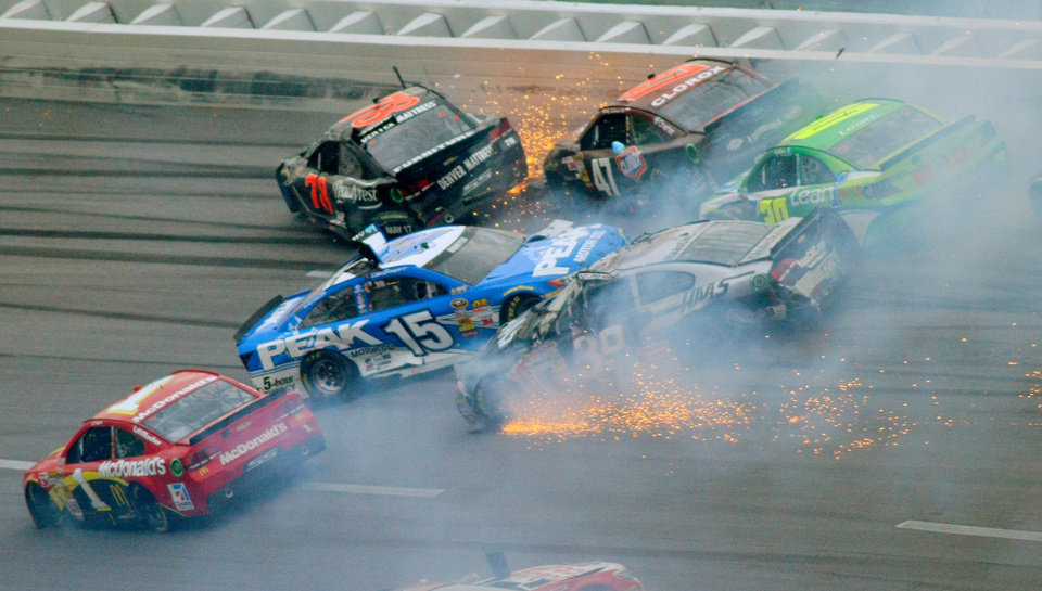 Photo - Drivers including Jamie McMurray (1), Clint Bowyer (15), Kurt Busch (78), Bobby Labonte, Ryan Newman (39 and David Stremme (30) collide in Turn 3 during the NASCAR Sprint Cup Series Aaron's 499 auto race at Talladega Superspeedway in Talladega, Ala., Sunday, May 5, 2013. (AP Photo/Greg McWilliams)