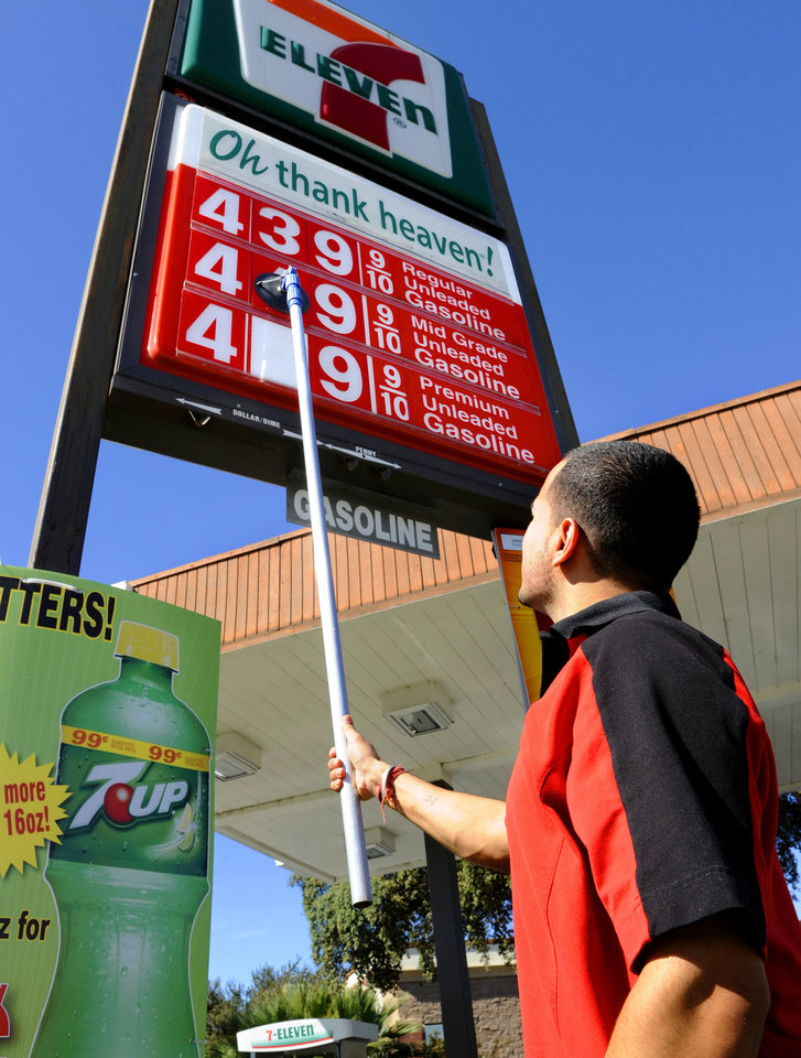 Store manager Deepak Sharma changes the fuel price sign by a whopping 20-cents a gallon at a 7-Eleven store in Vacaville, Calif. Friday, Oct. 5, 2012. Californians woke up to a shock Friday as overnight gasoline prices jumped by as much as 20 cents a gallon in some areas, ending a week of soaring costs that saw some stations close and others charge record prices. The average price of regular gas across the state was nearly $4.49 a gallon, the highest in the nation, according to AAA\'s Daily Fuel Gauge report. (AP/Photo, The Reporter, Rick Roach)