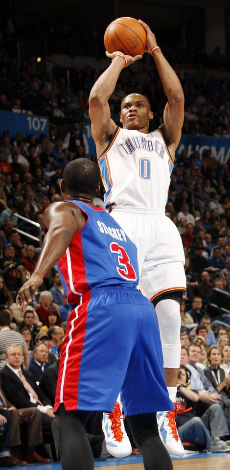 Oklahoma City's Russell Westbrook (0) shoots over Rodney Stuckey (3) of Detroit during the NBA basketball game between the Detroit Pistons and Oklahoma City Thunder at the Chesapeake Energy Arena in Oklahoma City, Monday, Jan. 23, 2012. Photo by Nate Billings, The Oklahoman
