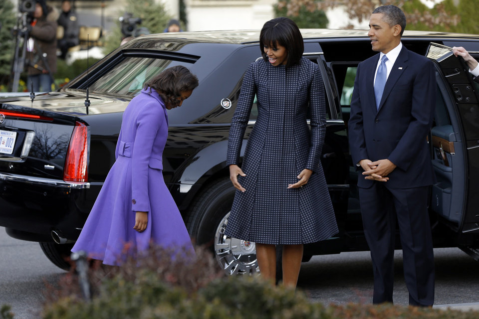President Barack Obama, first lady Michelle Obama and daughter Sasha arrives at St. John's Church in Washington, Monday, Jan. 21, 2013, for a church service during the 57th Presidential Inauguration.  (AP Photo/Jacquelyn Martin)