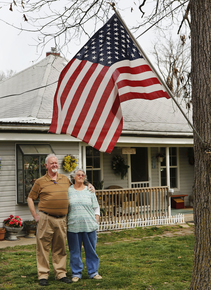 Photo - Lance Cpl. Thomas A. Blair's dad, Al Blair Jr. and his wife, Faye, stand outside their home in Gravette, Ark. Photo by Jim Beckel, The Oklahoman  Jim Beckel