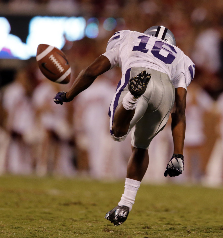 Photo - Kansas State's Tyler Lockett (16) avoids contact with the ball on a kickoff return during the second half of a college football game where the University of Oklahoma Sooners (OU) lost 24-19 to the Kansas State University Wildcats (KSU) at Gaylord Family-Oklahoma Memorial Stadium, Saturday, September 22, 2012. Photo by Steve Sisney, The Oklahoman