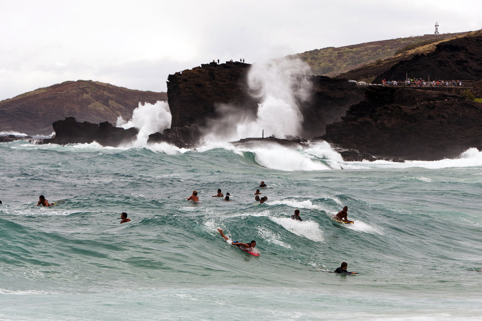 Photo - Surfers and body boarders fight for waves at Sandy Beach Park, Friday, Aug. 8, 2014, in Honolulu.  High surf is expected in some spots on Oahu due to Tropical Storm Iselle.  (AP Photo/Marco Garcia)