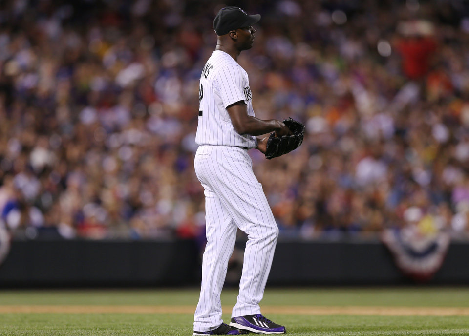 Photo - Colorado Rockies relief pitcher LaTroy Hawkins reacts after giving up the go-ahead run on a single to Los Angeles Dodgers' Juan Uribe in the ninth inning of the Dodgers' 3-2 victory in a baseball game in Denver, Thursday, July 3, 2014. (AP Photo/David Zalubowski)