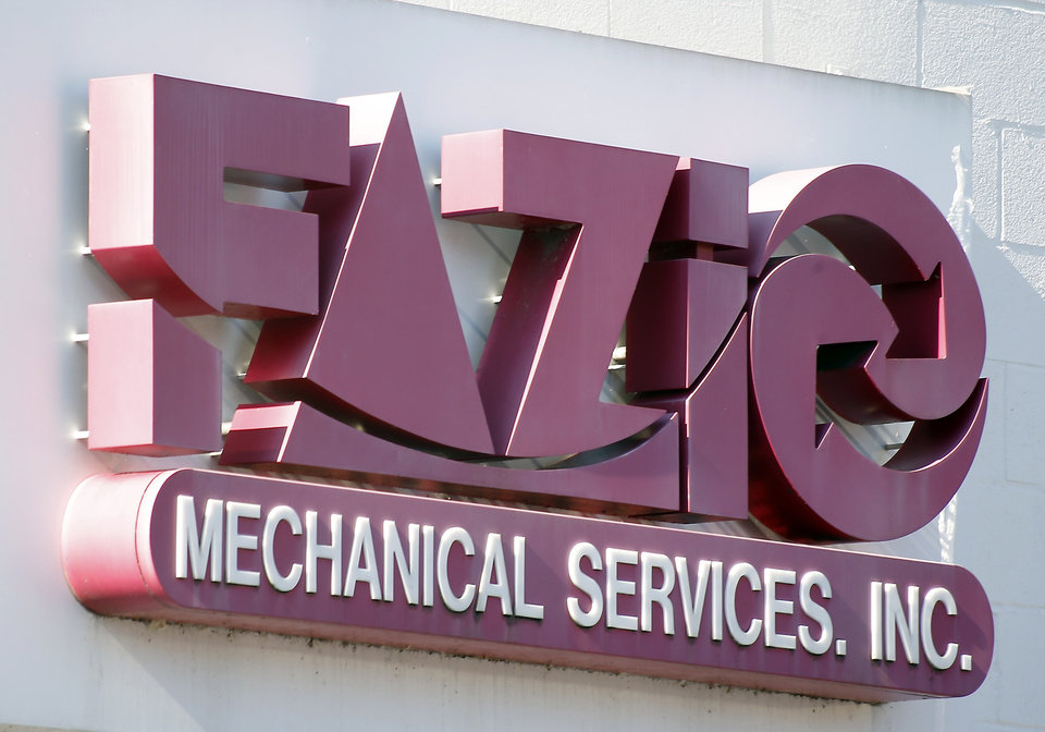 Photo - A sign for Fazio Mechanical Services Inc. is at their location in Sharpsburg, Pa. on Friday, Feb. 7, 2014. The western Pennsylvania heating and refrigeration contractor issued the statement late Thursday, Feb. 6, 2014 saying it was the victim of a