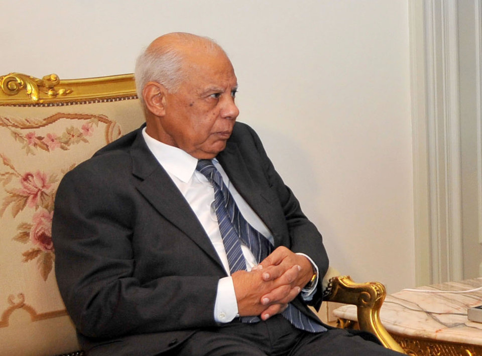 Photo - In this image released by the Egyptian Presidency, Hazem el-Beblawi meets with interim President Adly Mansour, unseen, in Cairo, Egypt, Tuesday, July 9, 2013. The spokesman of Egypt's interim president says a prominent economist, Hazem el-Beblawi, has been named prime minister and pro-democracy leader Mohamed ElBaradei as a vice-president. Ahmed el-Musalamani made the announcements Tuesday after days of political stalemate over the prime minister post. El-Beblawi, who is in his 70s, served as finance minister in one of the first cabinets formed after the 2011 uprising forced Hosni Mubarak from power and the military stepped in to rule. (AP Photo/Egyptian Presidency)