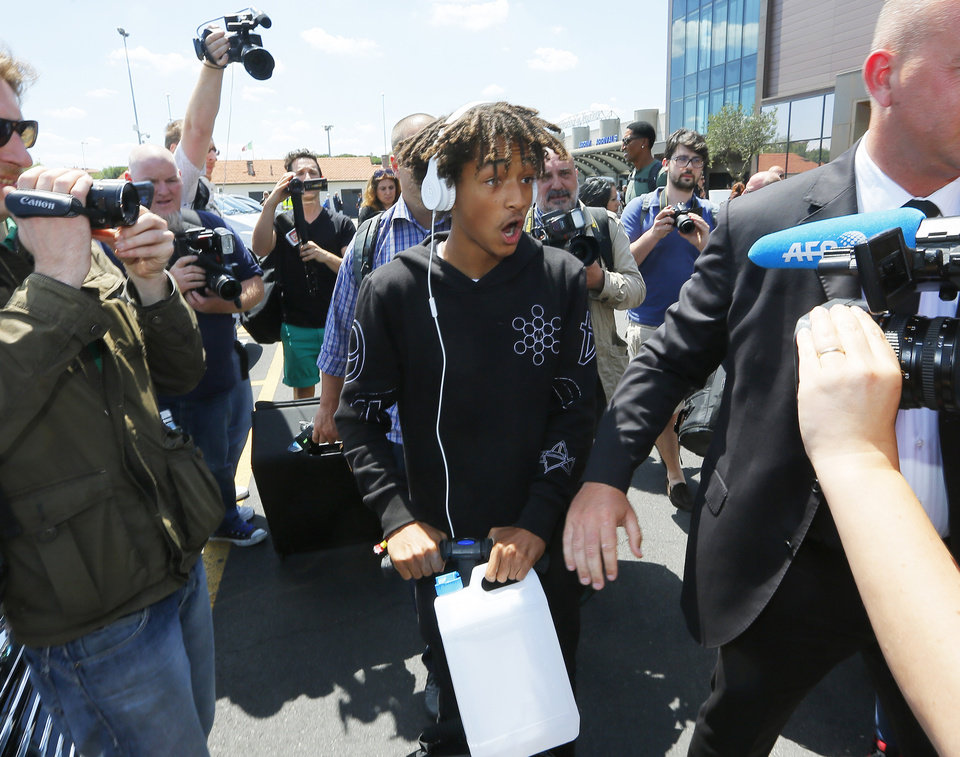 Photo - American actor and rapper Jaden Smith arrives in Florence, Italy, Saturday, May 24, 2014. Kim Kardashian and Kanye West will wed and host a reception at Florence's imposing 16th-century Belvedere Fort on May 24, according to a spokeswoman at the Florence mayor's office. The couple rented the fort, located next to Florence's famed Boboli Gardens, for 300,000 euros ($410,000) and a Protestant minister will preside over the ceremony. Belvedere Fort was built in 1590, believed using plans by Don Giovanni de' Medici. Located near the Arno River, it offers a panoramic view of Florence and the surrounding Tuscan hills. (AP Photo/Fabio Muzzi)