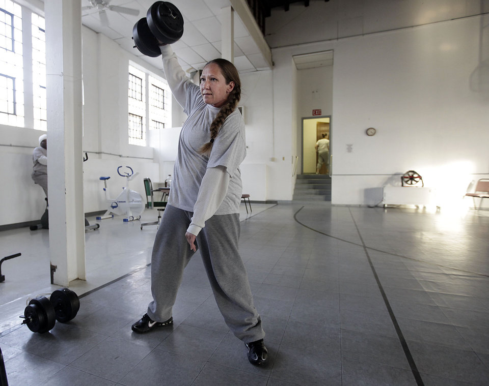 Jennifer Langston lifts weights at Eddie Warrior Correctional Center Dec. 1, 2010. MIKE SIMONS/Tulsa World
