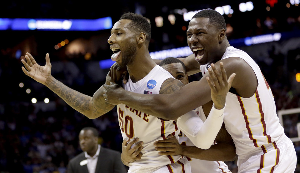 Photo - Iowa State's DeAndre Kane (50) is grabbed by teammates Monte Morris, center, and Daniel Edozie, right, after making the game-winning basket against North Carolina during the second half of a third-round game in the NCAA college basketball tournament Sunday, March 23, 2014, in San Antonio. Iowa State won 85-83. (AP Photo/David J. Phillip)