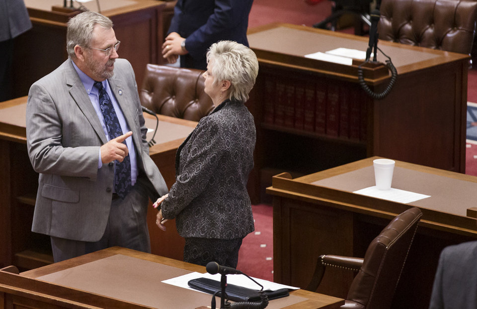 Photo - Jack Fry and Julie Daniels speak as members of the Oklahoma State Senate reconvene to pass a resolution to have the House of Representatives hear a bill to raise the gross production tax to four percent at the State Capitol in Oklahoma City, Okla. on Thursday, Oct. 26, 2017. Photo by Chris Landsberger, The Oklahoman