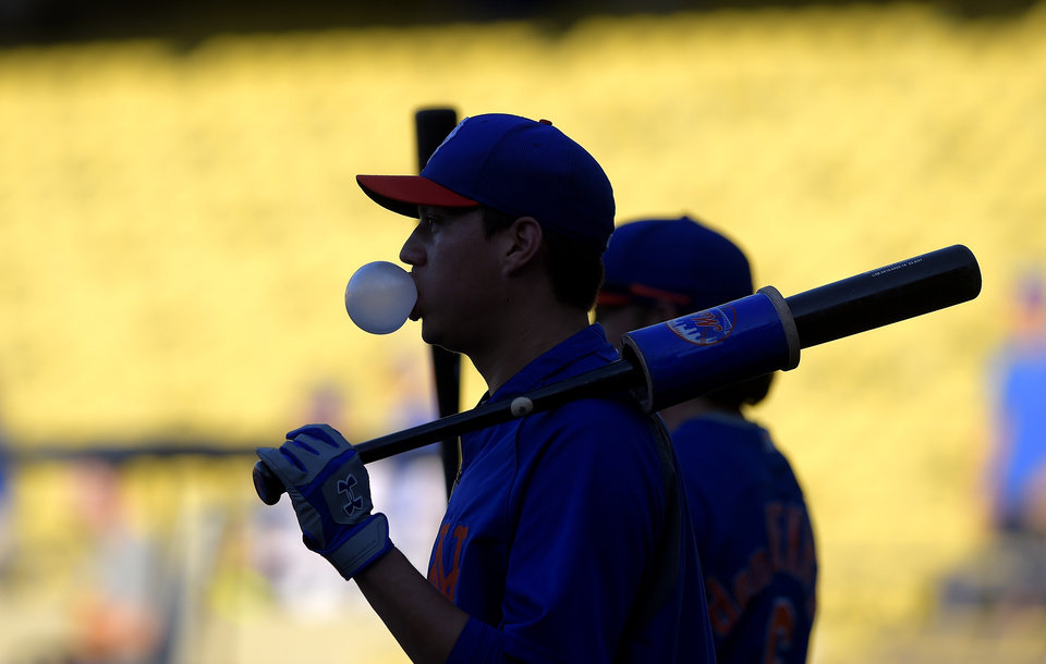 Photo - New York Mets' Wilmer Flores blows bubbles as he waits to hit during batting practice for a baseball game against the Los Angeles Dodgers, Friday, Aug. 22, 2014, in Los Angeles. (AP Photo/Mark J. Terrill)