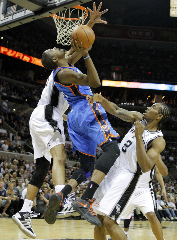 Oklahoma City\'s Kevin Durant (35) gets stuck between San Antonio\'s Tim Duncan (21) and Kawhi Leonard (2) during Game 1 of the Western Conference Finals between the Oklahoma City Thunder and the San Antonio Spurs in the NBA playoffs at the AT&T Center in San Antonio, Texas, Sunday, May 27, 2012. Oklahoma City lost 101-98. Photo by Bryan Terry, The Oklahoman