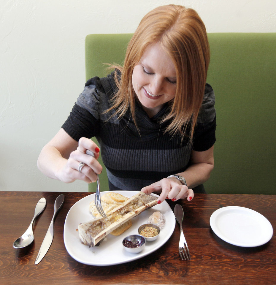 Photo - Erica Millar eats Roasted Bone Marrow for the first time at Ludivine in Oklahoma City, Thursday, Feb. 16, 2012. Photo by Nate Billings, The Oklahoman