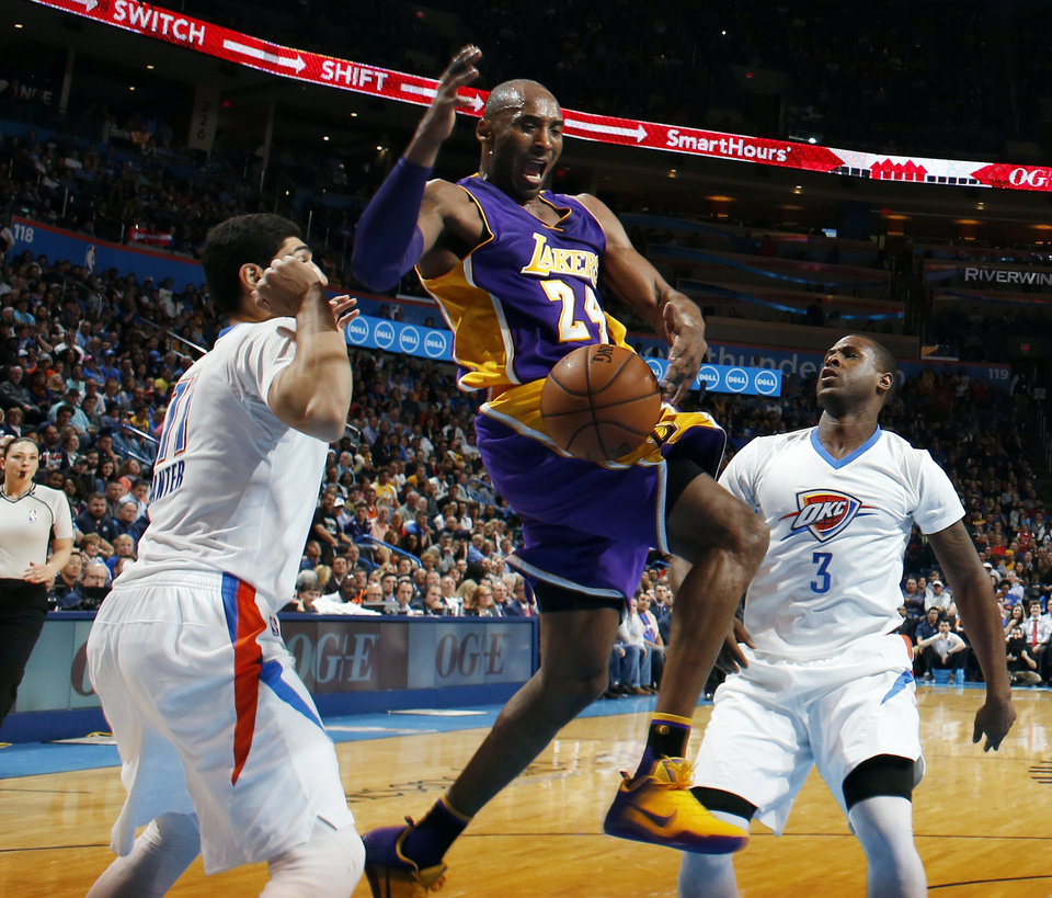 Photo - Los Angeles' Kobe Bryant (24) loses the ball between Oklahoma City's Enes Kanter (11) and Dion Waiters (3) during an NBA basketball game between the Oklahoma City Thunder and the Los Angeles Lakers at Chesapeake Energy Arena in Oklahoma City, Monday, April 11, 2016. [Nate Billings/The Oklahoman Archives]